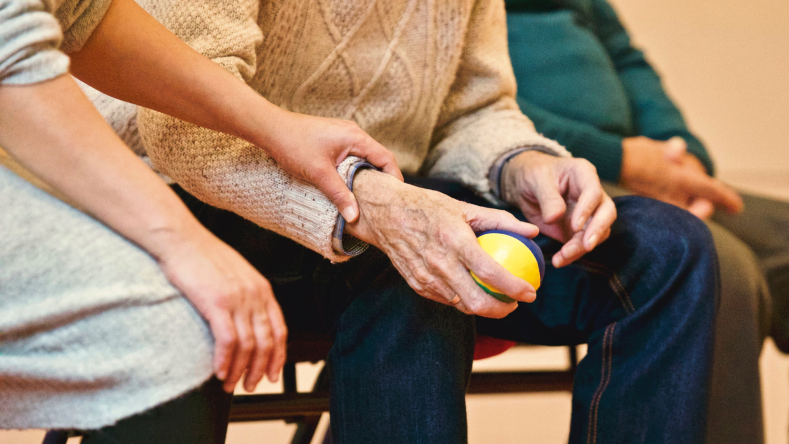 Younger adult caring for elderly.